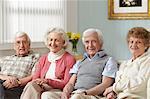 Four seniors in care home, portrait