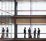 Business people talking in modern office corridor
