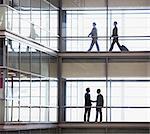 Businesswomen walking along corridor in modern office