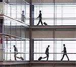 Businessmen walking along corridor in modern office