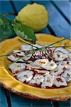 Carpaccio de poulpe vinaigrette au vinaigre balsamique