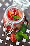 Open jar of summer fruit