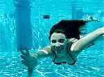 Italy, Ravello, Underwater portrait of swimming woman