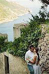 Italy, Ravello, Mature couple kissing in narrow lane