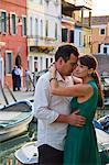 Italy, Burano, Mature couple embracing