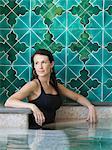 Italy, Amalfi Coast, Ravello, Mature woman in swimming pool looking away