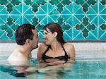 Italy, Amalfi Coast, Ravello, Mature couple laughing in swimming pool