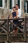 Italy, Venice, Mature couple embracing on bridge