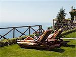 Italy, Amalfi Coast, Ravello, Mature couple lying on lounge chairs