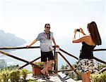 Italy, Amalfi Coast, Ravello, Woman taking picture of men
