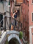 Italy, Venice, Woman standing on footbridge