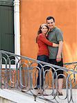Italy, Venice, Mature couple standing on balcony