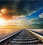 railway to horizon under dramatic sky