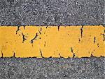 This is a line sign on asphalt road have a broken