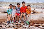 Kids on a beach log