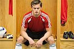 Soccer player sitting in locker room