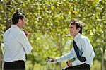 Businessmen talking outdoors