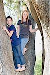 Two Teenage Girls in Tree