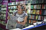 Woman in a magazine shop, main station, Munic, Bavaria, Germany, Europe
