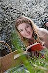 Blond woman reading on meadow