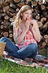 Woman eating melon