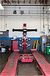 Empty hoist in automobile repair shop