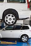 Car on hoist in automobile repair shop