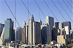 View of lower Manhattan through suspension cables of the brooklyn bridge, manhattan, new york, America, usa