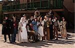Townspeople posing outside in an American old west scene