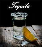 Tequila shot with lemon slice and salt
