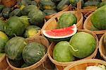 Organic Seedless Watermelon in Wooden Baskets at Farmer's Market