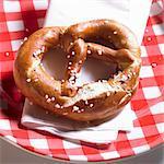 Lye pretzel on a plaid plate