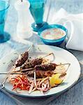 Minced lamb kebab with a yogurt dip