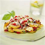 Cuisson de pommes de terre, poivrons rouges et mozzarella