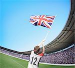 Man In Stadium Waving British Flag