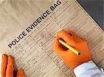 Scientist filling out evidence bag