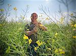 Farmer examining rapeseed crop