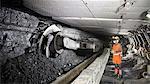 Coal miner working in mine
