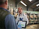 Farmer and vet talking in milking parlor