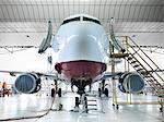 Airplane docked in hangar
