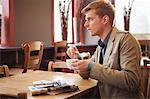 Man drinking tea in a restaurant