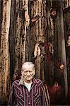 Senior man outside barn, portrait