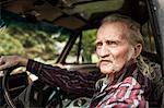 Senior man inside car