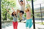 Three friends jumping