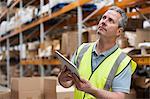 Man in warehouse using digital tablet