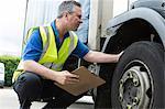 Man checking truck tire