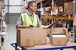 Man using barcode reader in warehouse