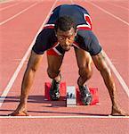 Athlete on starting blocks