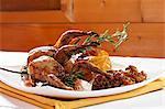 Roast quail with chanterelle mushrooms