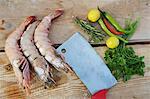 Jumbo shrimp, chili peppers, herbs, lemons and cleaver